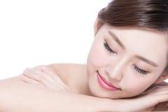 Charming woman Smile enjoy spa. Charming woman face Smile enjoy spa and massage while lying  on white background, asian girl Royalty Free Stock Photo