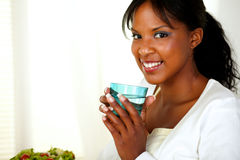 Charming woman smiling and drinking fresh water Royalty Free Stock Photography