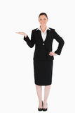 Charming woman in suit showing a copy space Royalty Free Stock Photos