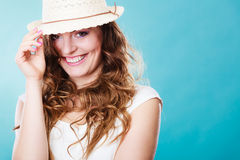 Charming woman in summer straw hat Stock Photography