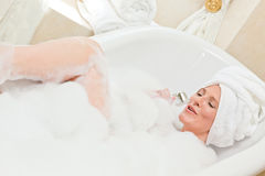 Charming woman taking a bath Stock Image