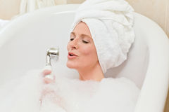 Charming woman taking a bath Royalty Free Stock Photos
