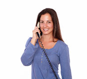 Charming woman talking on phone while smiling Stock Photos