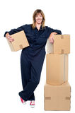 Charming woman in uniform posing with cartons Stock Photo