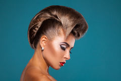 Charming woman with unusuall hairstyle looking down Stock Image