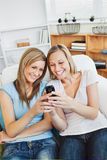 Charming woman using a cellphone at home Stock Photo