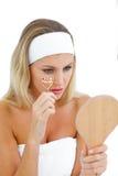Charming woman using an eyelash curler Stock Photo