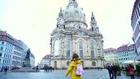 Charming woman walks in middle of main square of old European city Dresden on  winter day in street. stock video footage