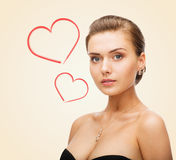 Charming woman wearing shiny diamond earrings Stock Photos
