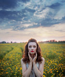 Charming woman among wild-flowers fields Royalty Free Stock Photo