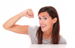 Charming woman with winning sign smiling Royalty Free Stock Photo