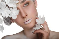 Charming woman with a winter make-up stock image