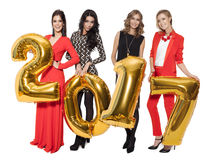 Charming Women Holding Big Golden Numbers 2017. Happy New Year. Stock Photography