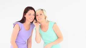 Charming women with a phone Royalty Free Stock Images
