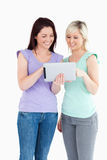 Charming women with a tablet Royalty Free Stock Images