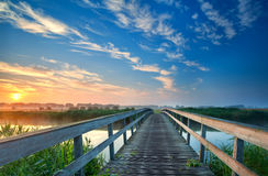 Charming wooden bridge over river Stock Photos
