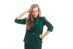 Charming youn business woman in green uniform posing on camera Stock Images