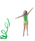 Charming young artistic gymnast dancing in studio Stock Photos