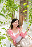 Charming Young Asian Woman Relaxing On Balcony Garden Stock Images