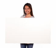 Charming young asiatic woman holding a white card Royalty Free Stock Photo