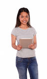 Charming young asiatic woman using her tablet pc Royalty Free Stock Photo