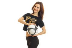 Charming young athletic girl smiles and holds the ball Stock Image
