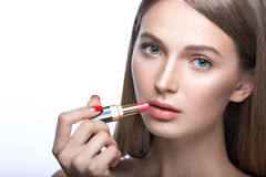 Charming young babe with lipstick and light makeup. Beauty face Royalty Free Stock Photos
