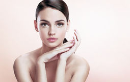 Charming young babe with perfect makeup, skin care concept Royalty Free Stock Images