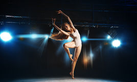 Charming young blonde ballet dancer posing on stage Stock Image