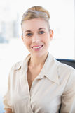 Charming young blonde businesswoman smiling at camera Stock Photography