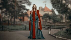 Free Charming Young Blonde Princess In The Medieval Green Dress With A Red Cape Royalty Free Stock Photo - 190712555