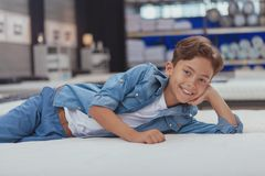 Charming young boy at the furniture store stock photography