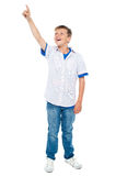 Charming young boy pointing towards copyspace area Stock Images