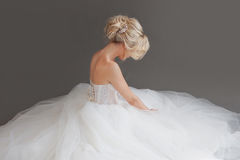 Free Charming Young Bride In Luxurious Wedding Dress. Pretty Girl In White. Gray Background. Back Stock Image - 82215071