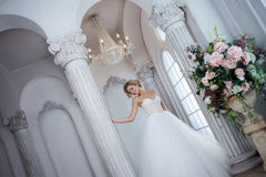 Charming young bride in luxurious wedding dress. Pretty girl, the photo Studio Royalty Free Stock Images