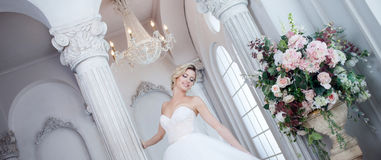 Charming young bride in luxurious wedding dress. Pretty girl, the photo Studio Stock Image