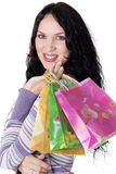 Charming young  brunette holding colorful shopping bags Royalty Free Stock Photography