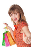 Charming young brunette holding colorful shopping bags Royalty Free Stock Images