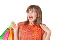 Charming young brunette holding colorful shopping bags Stock Photo