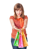 Charming young brunette holding colorful shopping bags Stock Photography