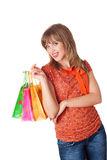Charming young brunette holding colorful shopping bags Stock Image