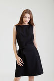 Charming young brunette posing in black dress Royalty Free Stock Images