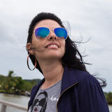 Charming young brunette in sunglasses. Beautiful girl on exotic vacation in remote island Stock Photography