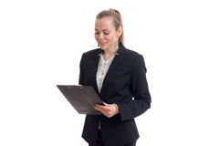 Charming young business Lady in black suit looks at Tablet. Isolated on white background Stock Photos