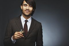 Charming young businessman having coffee Royalty Free Stock Images