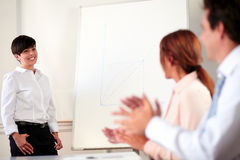 Charming young businesswoman giving a presentation Stock Photo