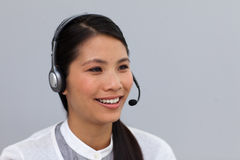 Charming young businesswoman with headset on stock images