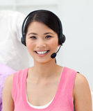 Charming young businesswoman talking on headset Royalty Free Stock Photos