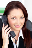 Charming young businesswoman talking on phone Royalty Free Stock Photos