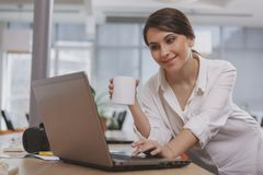 Charming young businesswoman working at her office stock photos